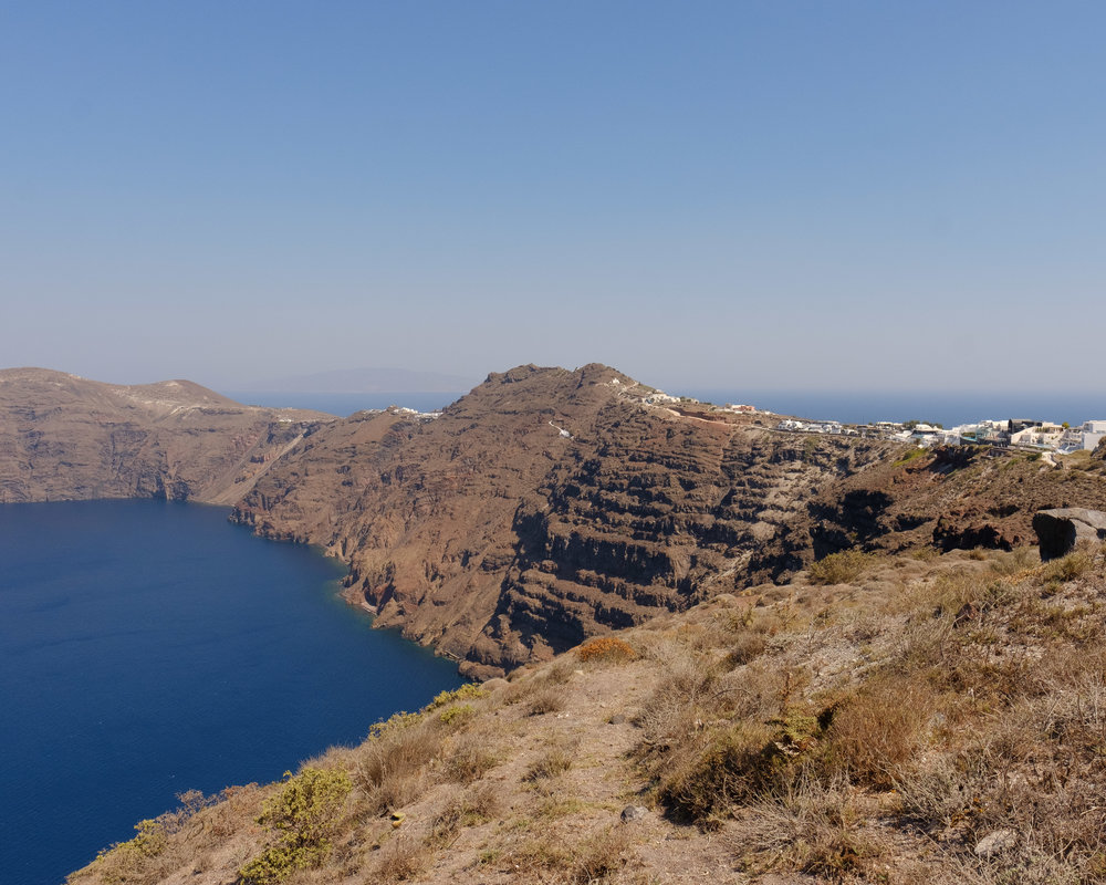 The hike goes all along this path with the view of the caldera on your left.
