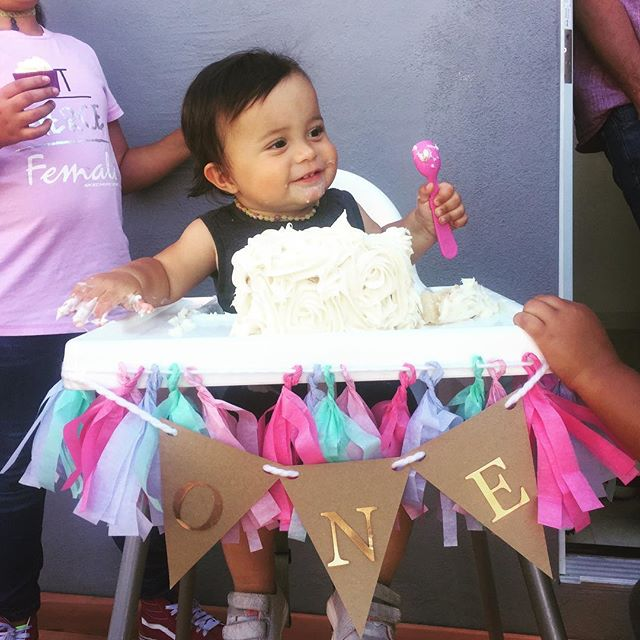 I just can't get over the cuteness of this darling baby. Also, the amazing cake! It's so fun to see all the growth that happens from a tiny newborn to this dancing, laughing child. And to know how much loving parenting goes into that!