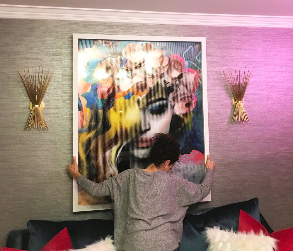 Me holding the artwork to figure out the placement of the art. My daughter was assisting me and took this shot.