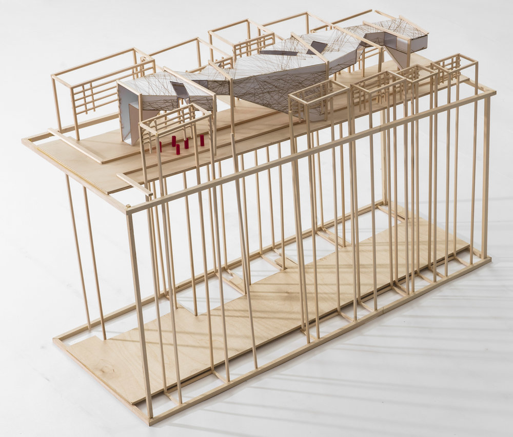 site model, with neighborhood homes acting as the framing for the intervention to exsisit between the building's windows
