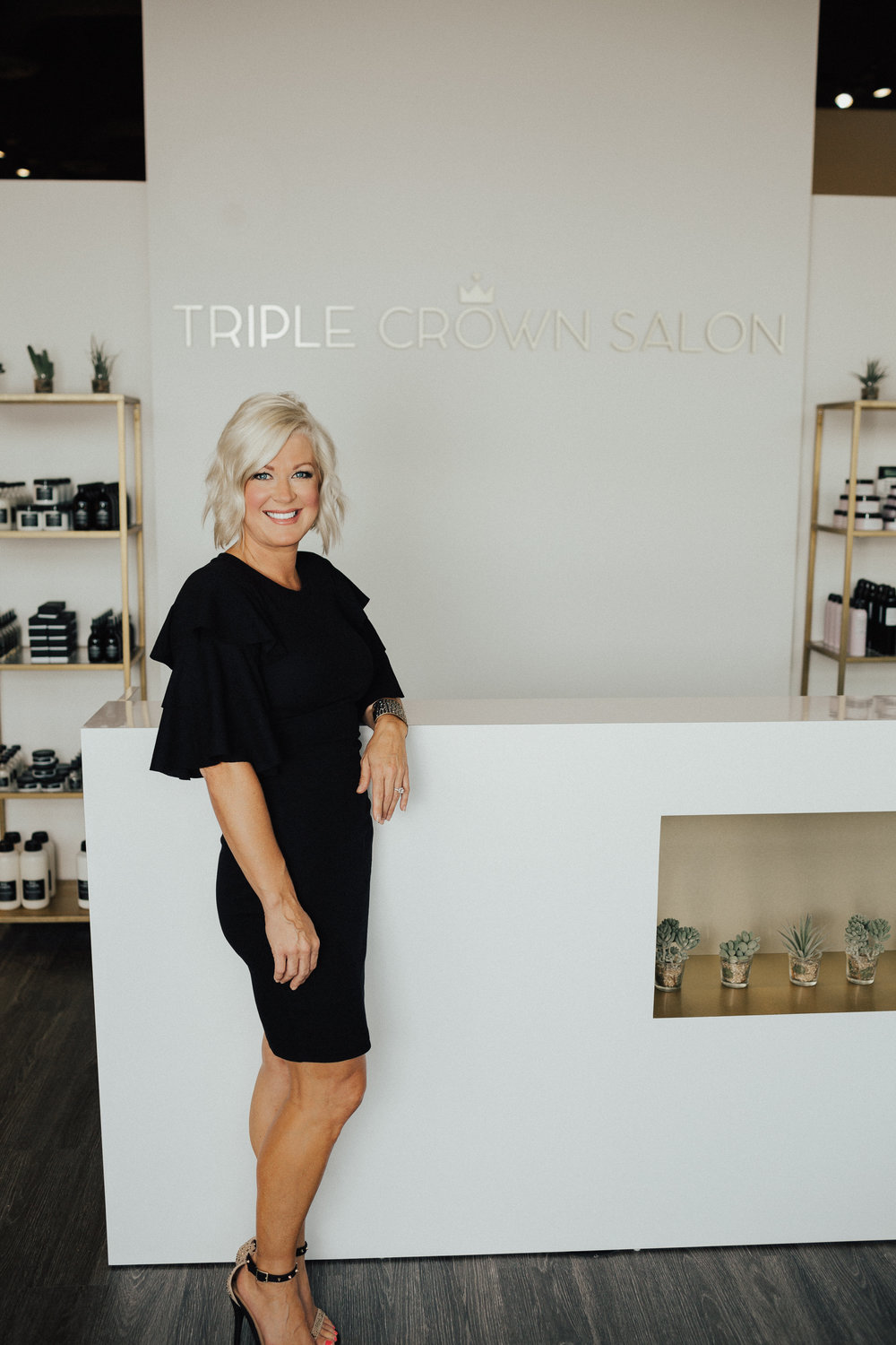 About - Triple Crown Salon owner Anne Heck understands that life can be a wild ride. Anne is a mom, a wife, and now a proud, new salon owner. She started professionally styling hair in 1997. She is a believer in on-going education and continues to educate herself and staff in the latest trends, techniques and products. At Triple Crown Salon, you will find stylists who are committed to helping you be authentically beautiful by creating a look that reflects your honest self. Because honestly, everybody is glamorous!Triple Crown Salon is a salon that values quality products designed to help you and our planet stay true, vibrant and beautiful. A certified Green Circle Salon, Triple Crown Salon is dedicated to leaving the smallest carbon footprint with an aggressive recycling program and energy efficient tools. Our Davines product line, imported from Italy, is made using all natural plant based ingredients. Davines is a company that is dedicated to respecting mother nature and sustainable beauty.