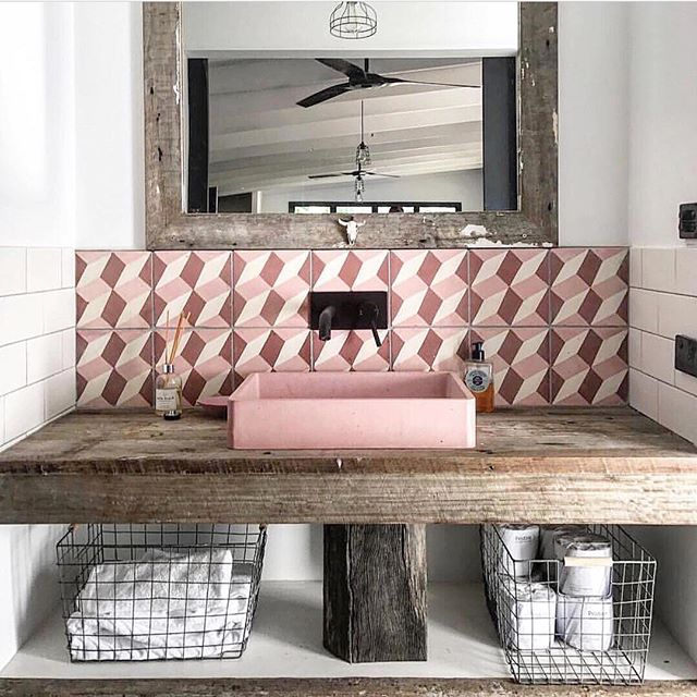 This beautiful bathroom by @riverhawkranch featuring a sink by @slabshapers and tiles by @jatanainteriors interiors is just breathtaking. It's such a bold move to combine the rustic bench and other elements with the graphic pink. It works perfectly! 💞 . . . #bathroomdecor #pinkbathroom #bathroomvanity #tileinspo #ihavethisthingwithpink #australianinteriors
