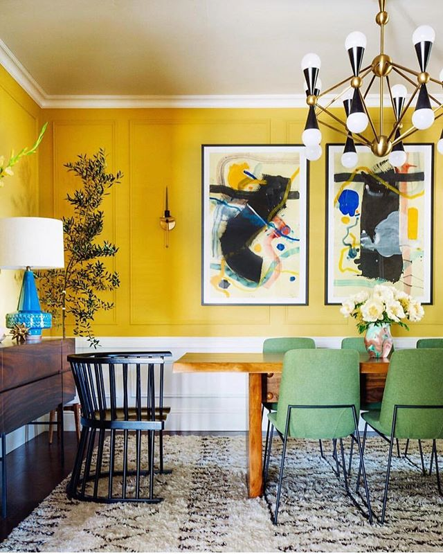 Still one of my favourite rooms  by @dabito for @oneroomchallenge 💛💛 Those Ochre panelled walls pairs particularly well with wood tones and then that amazing artwork, statement @jonathanadler light and the sage green which really makes it all sing 💚 . . . #diningroomdecor #retrofurniture #brass #chandelierstyle #modernluxe #orange #diningroominspo #wallpaper #statementlighting #midcenturymodern #colourpop #colourcrush #midcenturydecor #midcenturyfurniture #panelledwalls