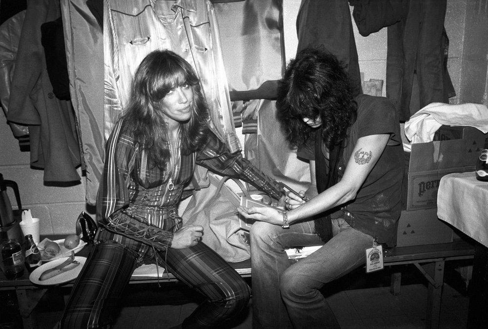 Carly Simon Steven Tyler writing phone number on arm NEW YORK CITY, 1979.jpg