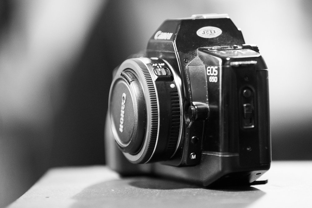 Photo courtesy of this lovely, lovely blog and review: go read it Bear with me… I have a new toy, a Canon EOS 650 - in lovingly looked after condition. And I want to shoot with it, but, I don't like the kit lens. I mean. ƒ5.6 - really? So… I want prime. And the 50mm ƒ1.8 is the stand out, cheap, good, option, but, I have the world's very best 50mm and manual camera set up - my OM1! Argh! This leaves me thinking of something quirky, and I think the 40mm (a length I like) ƒ2 might just be it. I mean, look at that combo!