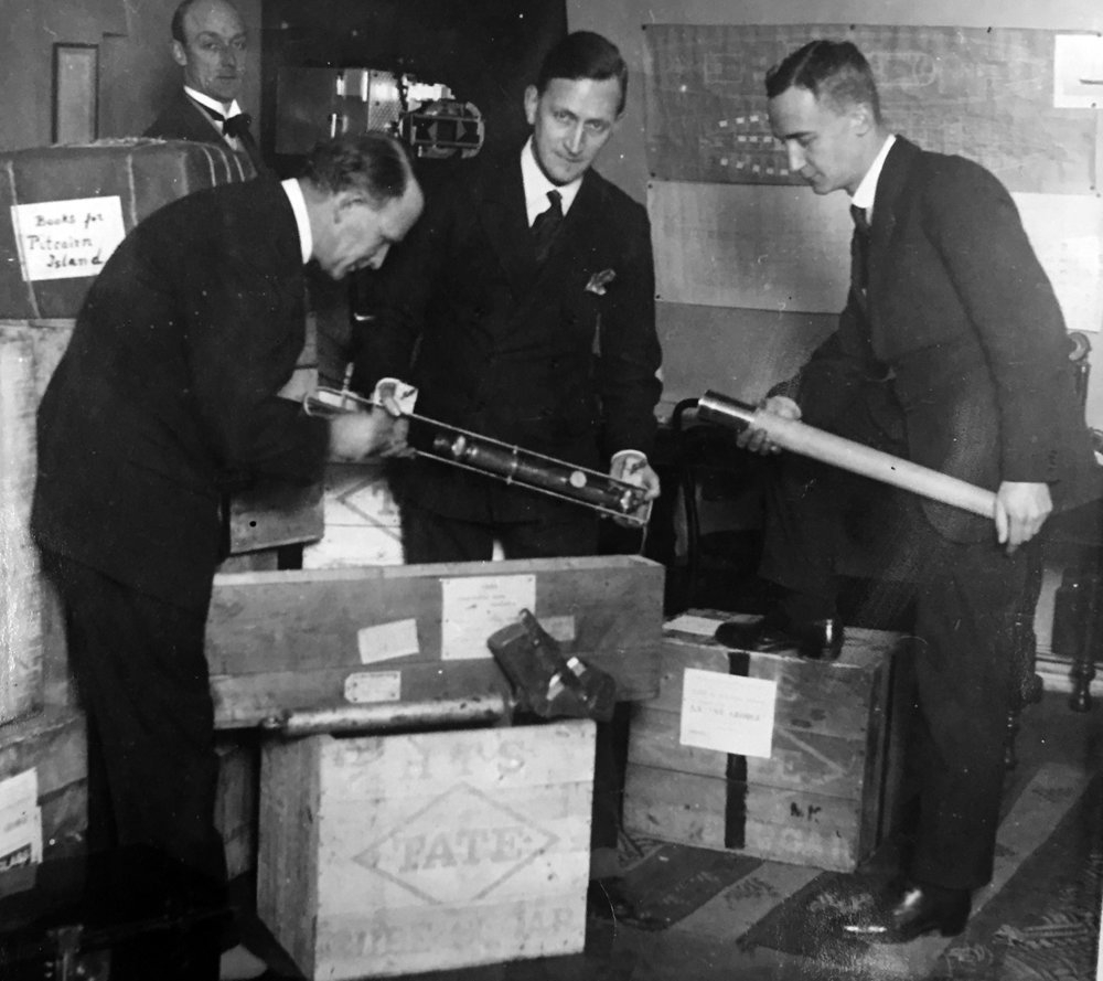 Commander David Blair (left) packing scientific instruments for an expedition to the South Pacific