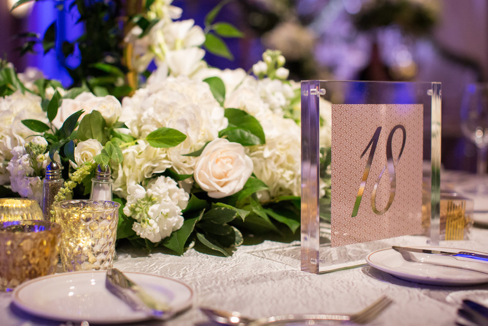 table-numbers-white-flowers-acrylic-purple-table-setting.jpg
