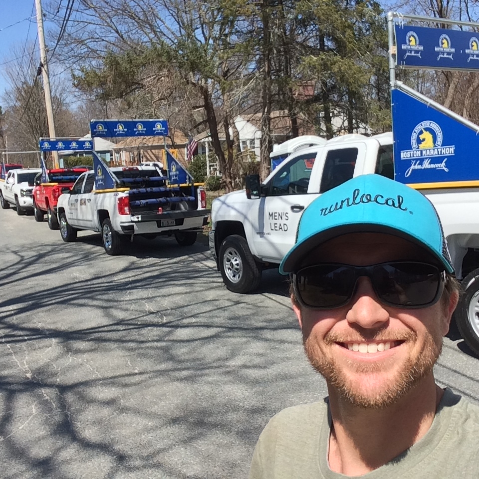 Even when Scotty's volunteering at the Boston Marathon he's still happy.