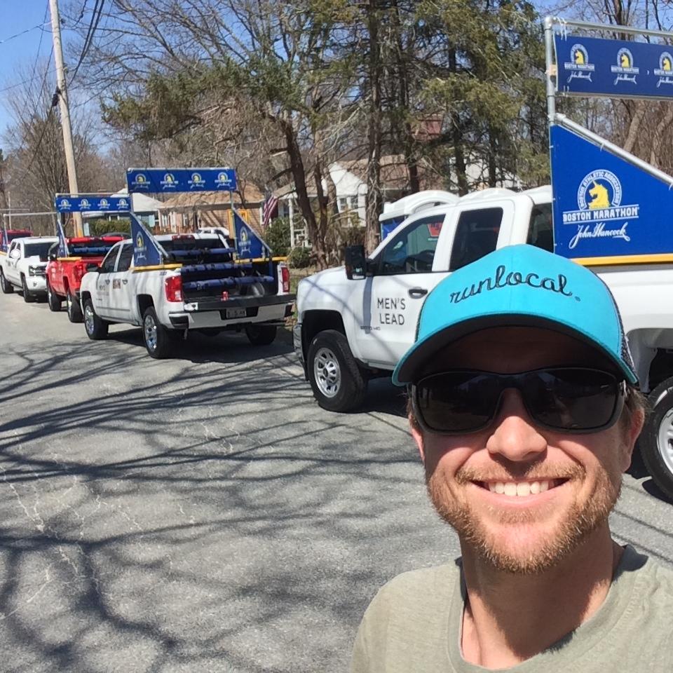 Even when Scotty's volunteering at the Boston Marathon he's still happy.