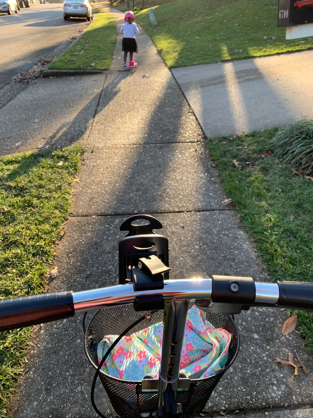 Nadia and I took advantage of the nice weather one afternoon this past week to scooter together around the neighborhood on our scooters. She was only a little bit faster than I was up the hill!