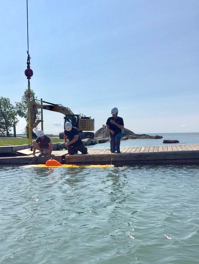Saturday, August 5, 2017 An excavator was brought in to dredge the marina exit and the Kraken Sonar crew got out into the lake by noon.