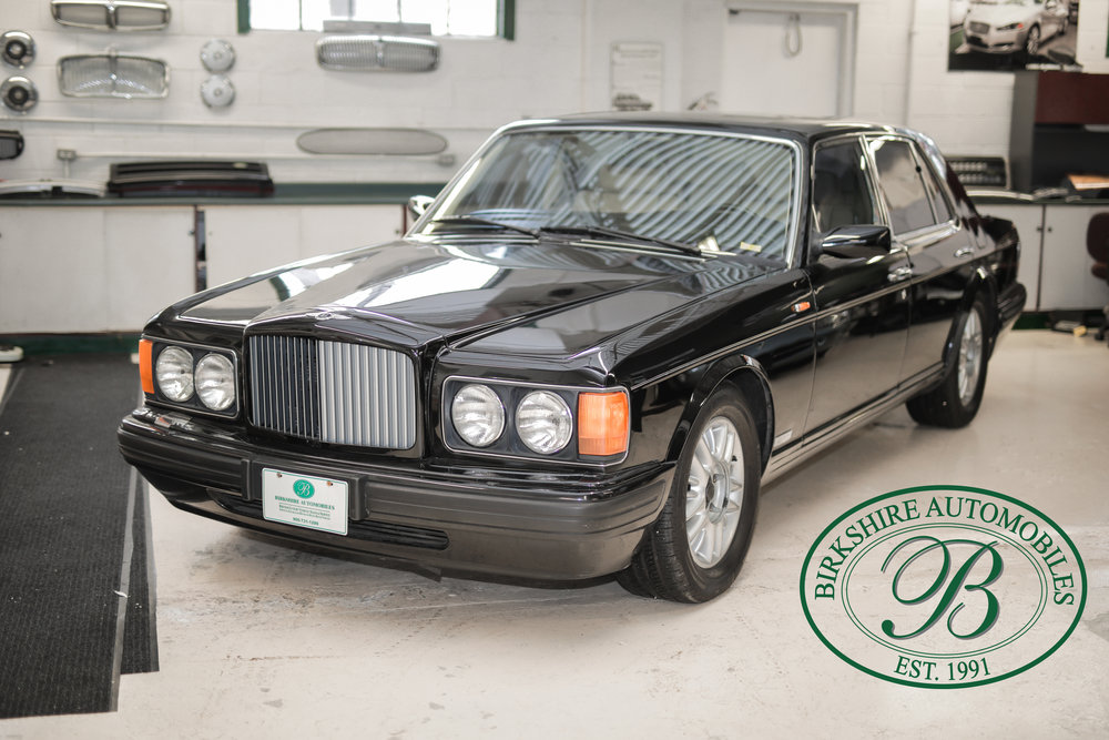 1997 Bentley Brooklands Turbo - No automobile possesses the flat-out exclusivity of a Bentley. There is no equal to a Bentley. Featuring hand-built coachwork, V8 turbo engine and luxurious interior - finished in a beautiful black on tan leather.