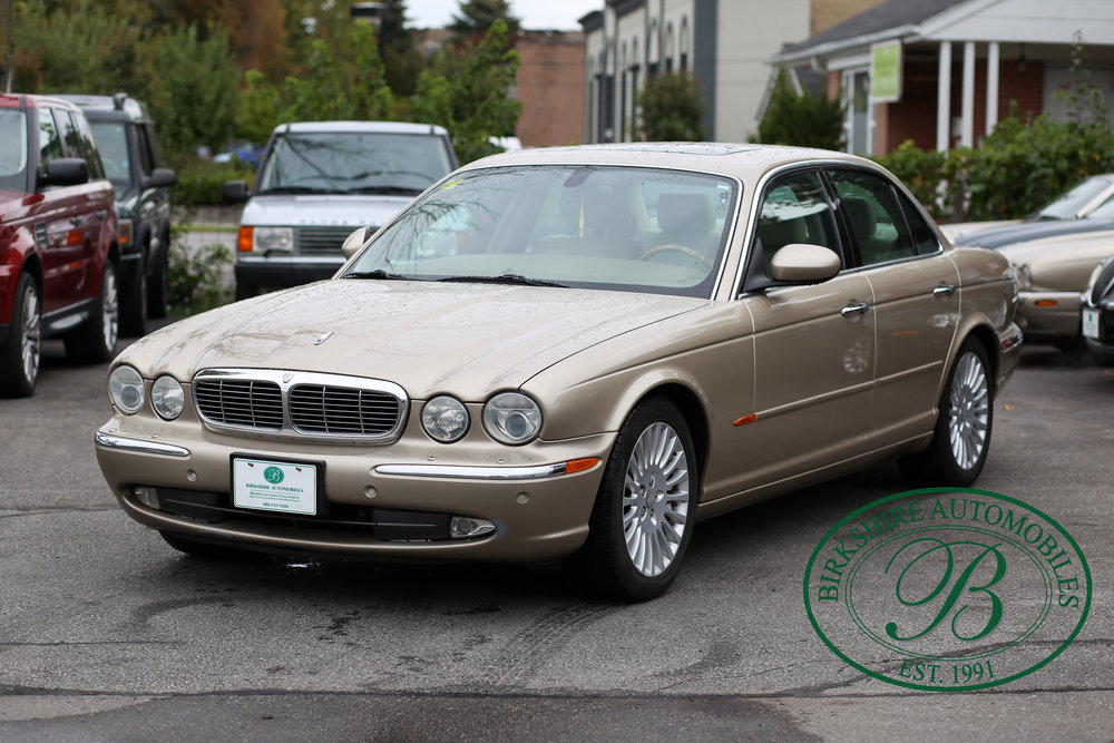 2004 Jaguar XJ8 - Offered for sale by Birkshire Automobiles. It's easy to find a comfortable driving position in this Jaguar XJ8, thanks in part to the wood-trimmed steering wheel that tilts and telescopes.