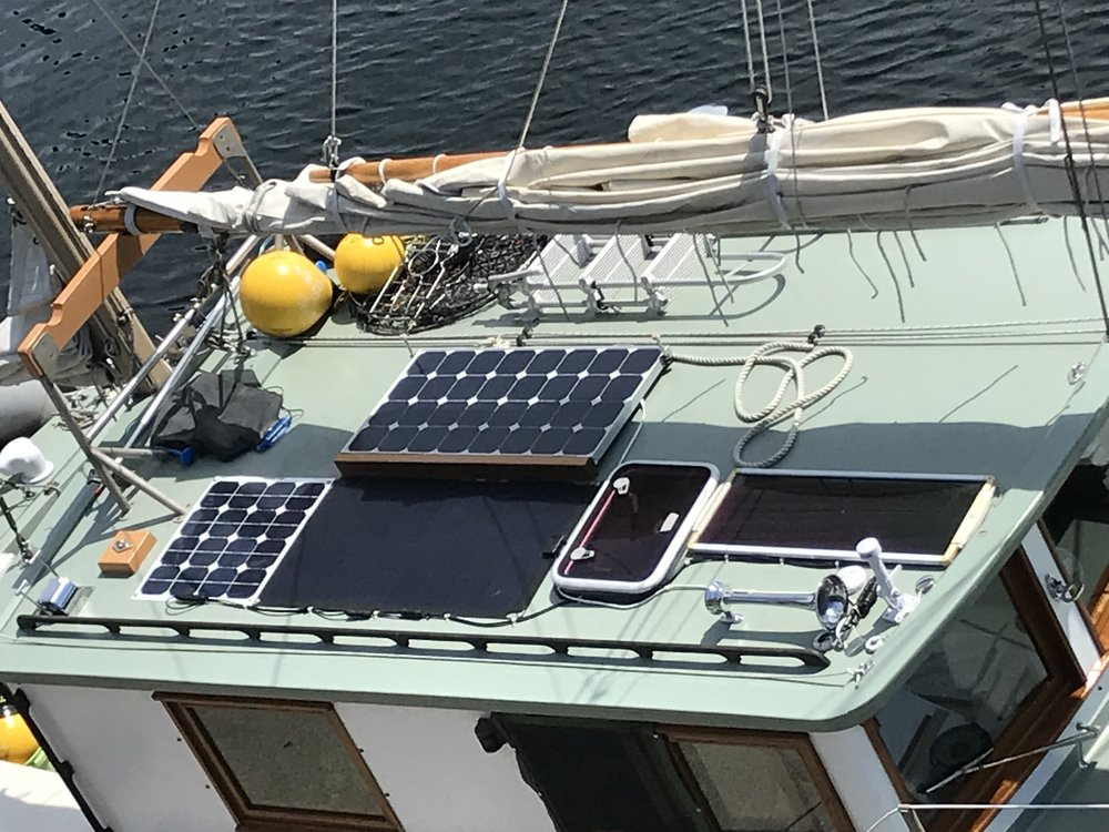 New 100 watt PV panel that folds down over adjacent panel when working with mainsail