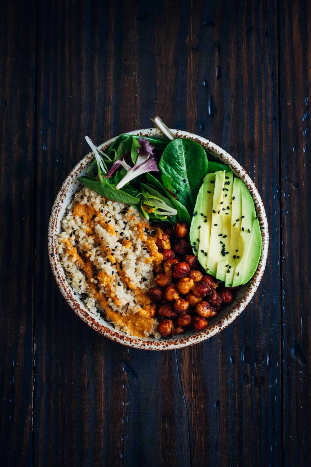 You can find a healthy bowl on menus across the country now, I love them!  They are the perfect way to prepare your balanced meal with protein, fats and carbs.  Try this amazing recipe at home. Post your pictures let me see.      The Vegan Buddha Bowl  This vegan buddha bowl has it all - fluffy quinoa, crispy spiced chickpeas, and mixed greens, topped with a mouthwatering red pepper sauce!   Prep Time 15 minutes  Cook Time 25 minutes  Total Time 40 minutes  Servings 2  Ingredients  Quinoa  1 Cup Quinoa rinsed  2 Cups Water  Chickpeas  1 1/2 Cups Cooked Chickpeas  Drizzle Olive Oil or other neutral oil  1/2 Tsp Salt  1/2 Tsp Smoked Paprika  1 Tsp Chili Powder  1/8 Tsp Turmeric  1/2 Tsp Oregano  Red Pepper Sauce  1 Red Bell Pepper ribs and seeds removed  2 Tbs Olive Oil or other neutral oil  Juice from 1/2 Lemon or more to taste  1/2 Tsp Pepper  1/2 Tsp Salt  1/2 Tsp Paprika  1/4 Cup Fresh Cilantro  Everything Else  Mixed Greens  An Avocado  Sesame Seeds for Garnish  Instructions  Start by cooking the quinoa. Bring 2 cups water to a boil, then add quinoa. Simmer for about 15 minutes until all water is absorbed. When done, remove from heat and keep covered for about 10 minutes so quinoa can absorb any excess water.  Preheat oven to 425. In a bowl, toss chickpeas, oil, and spices until chickpeas are evenly coated. On a baking sheet lined with parchment paper, bake chickpeas for 15-20 minutes, or until desired doneness is reached. When done, remove from oven and let cool.  To make red pepper dressing, add all dressing ingredients to a blender (not a food processor) and blend on high until smooth. Taste, and adjust seasonings to your preference.  Finally, assemble the Buddha bowls. In two bowls, add quinoa, mixed greens, avocado, and chickpeas. Drizzle everything with red pepper sauce, and sprinkle with sesame seeds.
