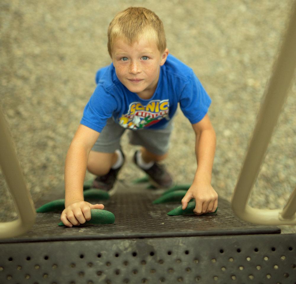 foothill climb boy looking up.jpg