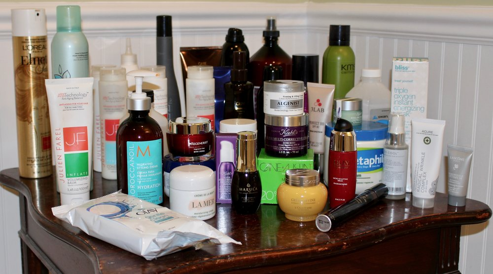 A sample of hair and skin products on hand.