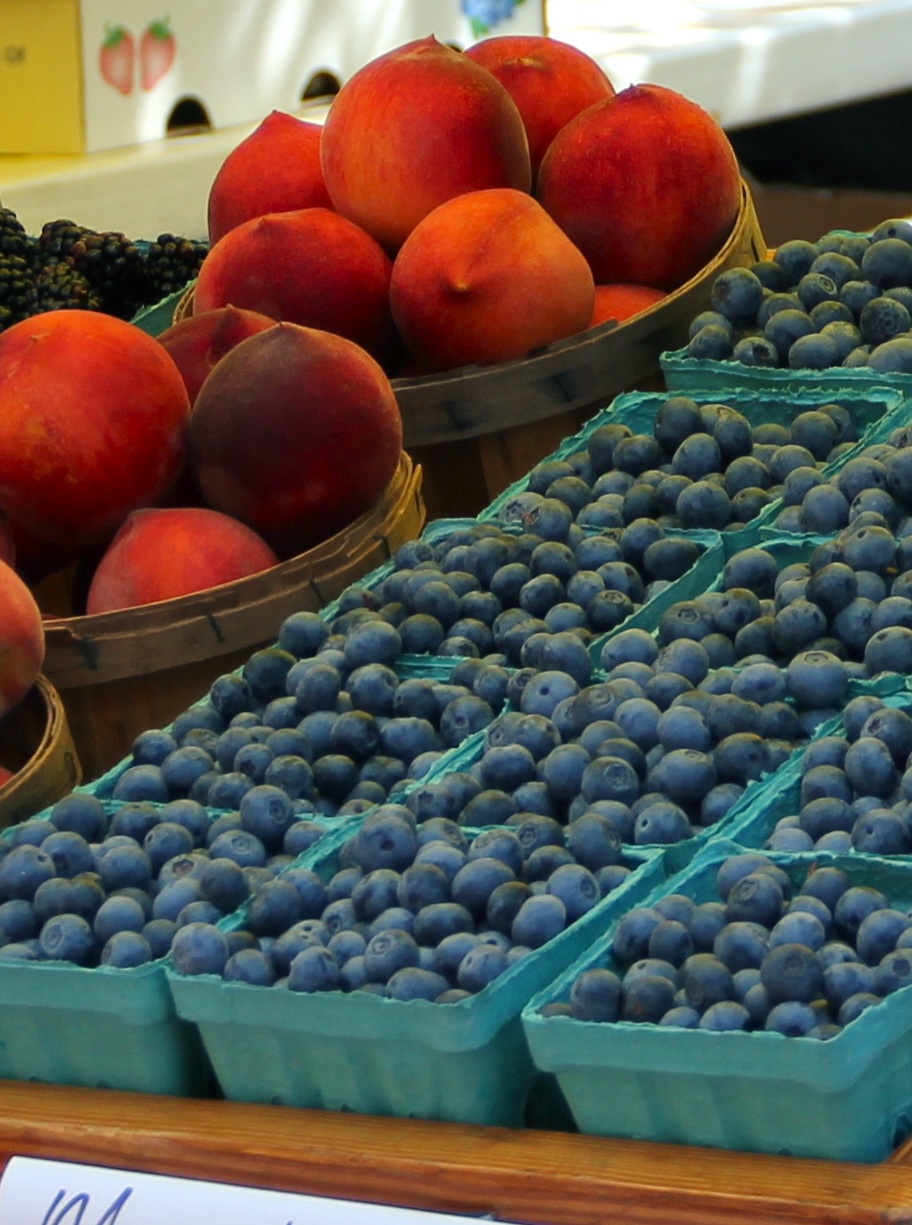 Berries and peaches at Farmers Market.jpg