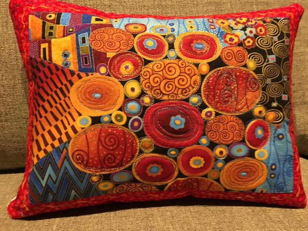 Pillow:  Ovals.  Reds, blues, orange.