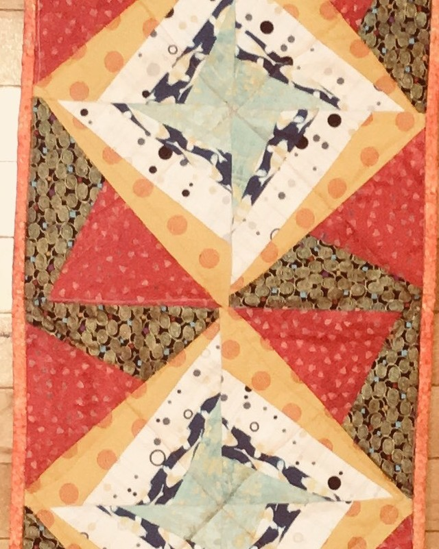 Table Runner:  Quilt tiles in greens, gold, red.