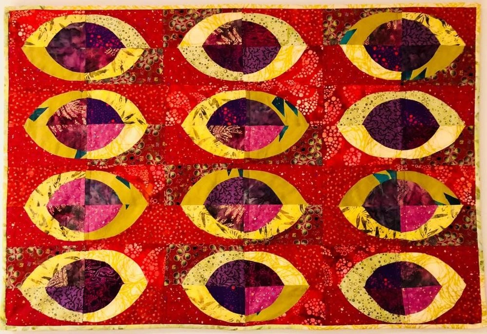 Quilt:  New design in gold, reds, purples.