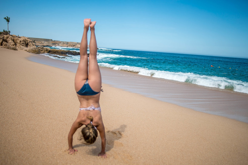 handstand at Chileno Beach