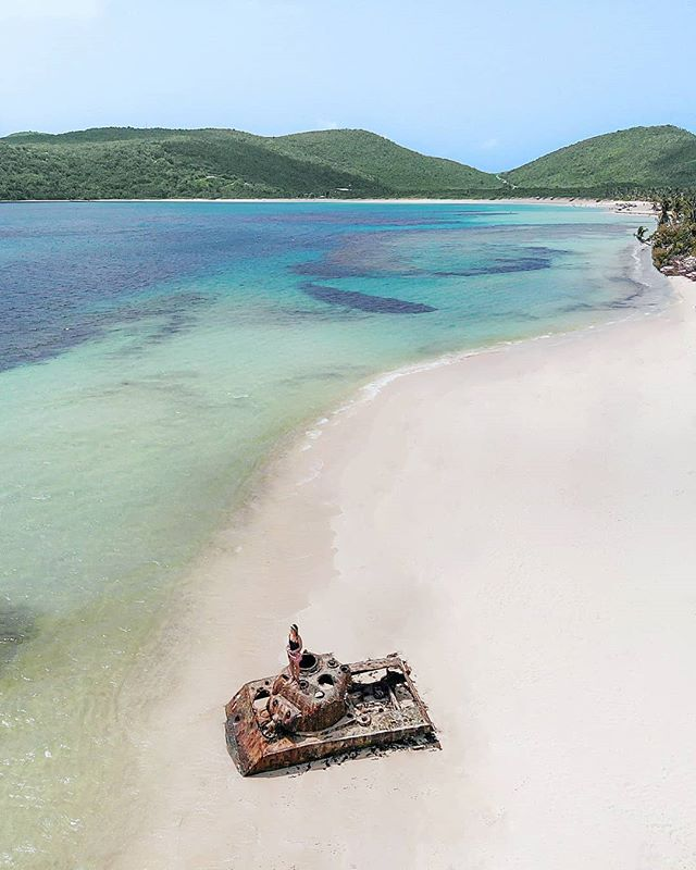 A midday dream in Isla Culebra. - One of the most distinctive views of this pristine bay is a rusting carcass of an old Sherman Tank sitting right on the outskirts of the main beach. I'm still a little confused why not that many people want to hang out with this unique and historic beach ornament. It's only a short stroll away from the huge beach crowds. What a treat.💣