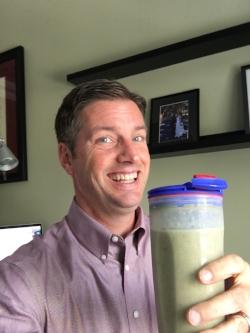 Enjoying a green smoothie at work.