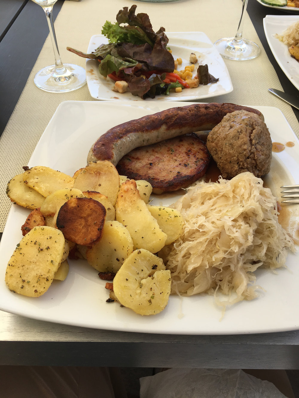 Yes, those are three types of sausages, including a type of liver sausage with sauerkraut & potatoes. Mmmmm!