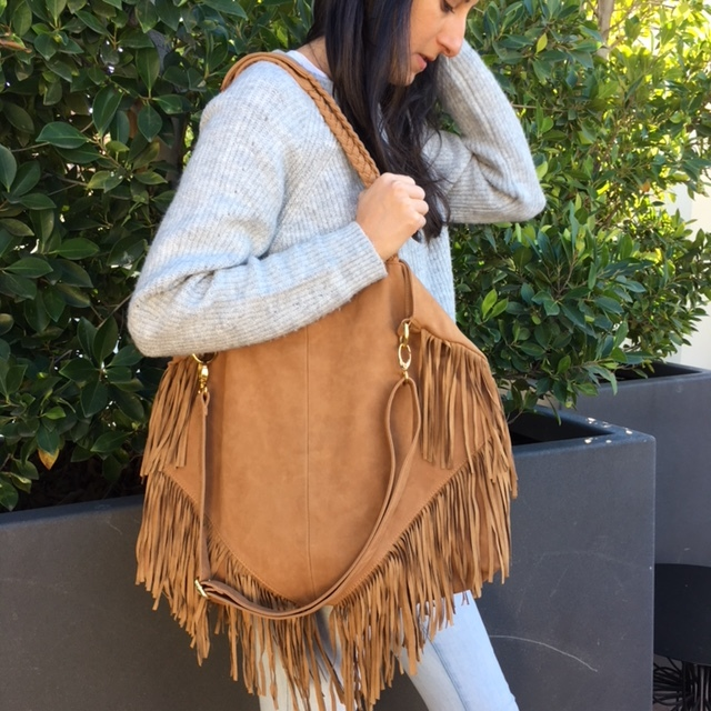 Cri De Cour vegan leather tote:  tan with fringe – great bigger purse, great color, cool and different.