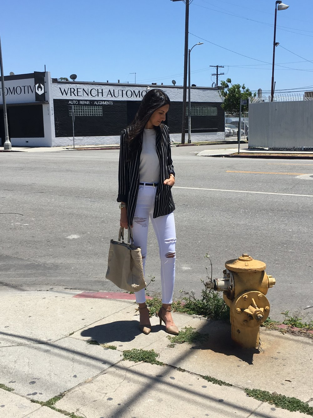 Professional Look - You can make white denim work for so many looks. Obviously, you can wear a pair that isn't distressed for an even more polished look. And even pair it with a silky blouse or something. But this would be my