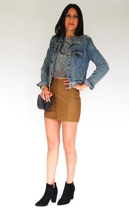 - vegan leather mini + sparkly pullover + jean jacket + black ankle boots + black crossbody