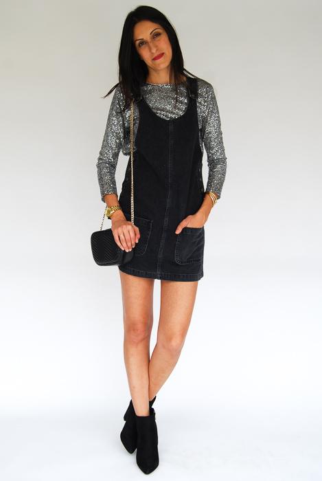- Black romper + sparkly pullover + black ankle boots + black crossbody