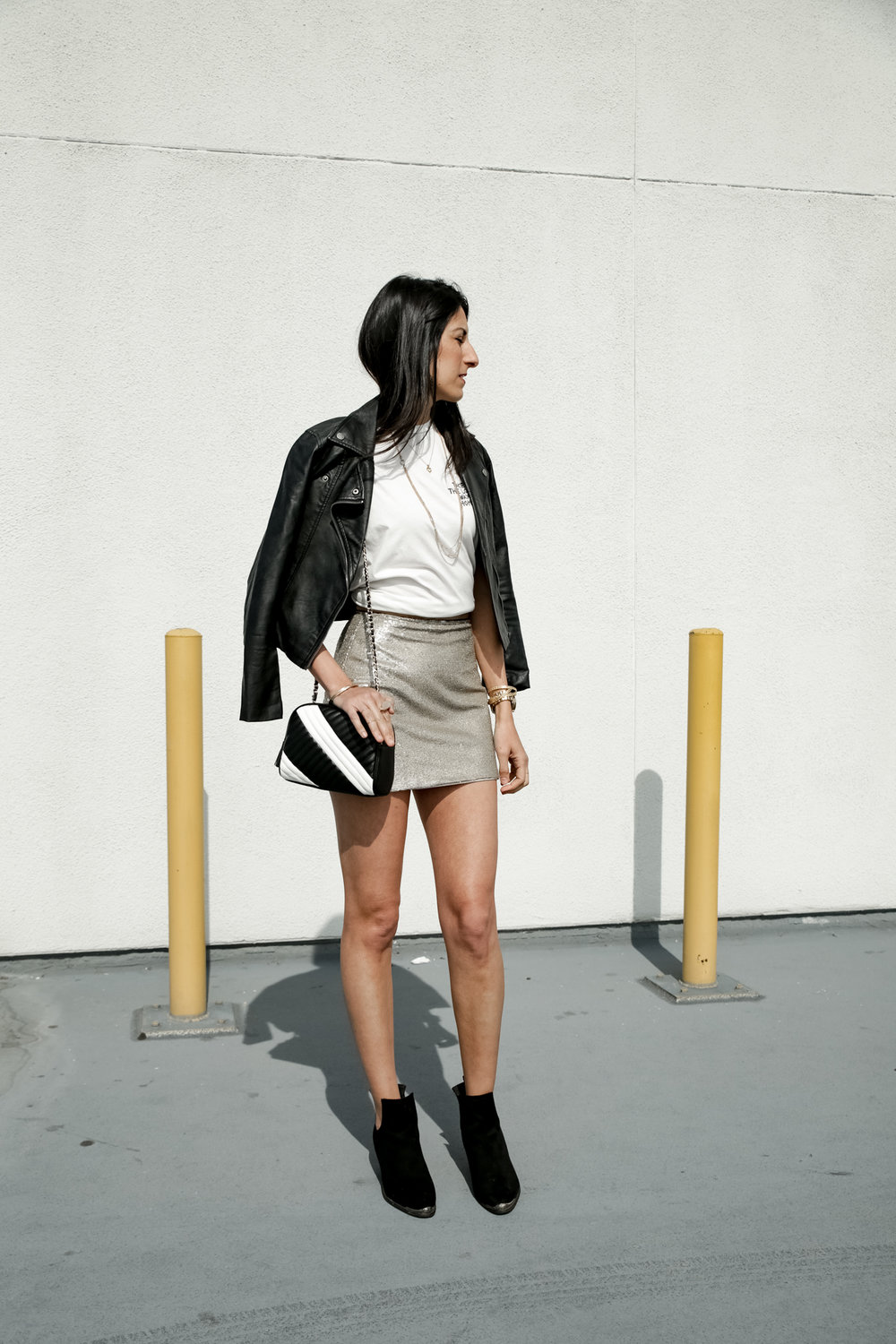 - 5. Forever21 Sparkly mini-knotted up, RVCA black leather jacket, F21 black and white bag, staple jewels