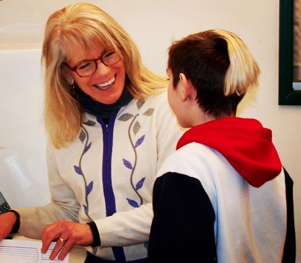 District nurse Joanne Broh talks to a Springfield student. (Via Springfield Public Schools Instagram)