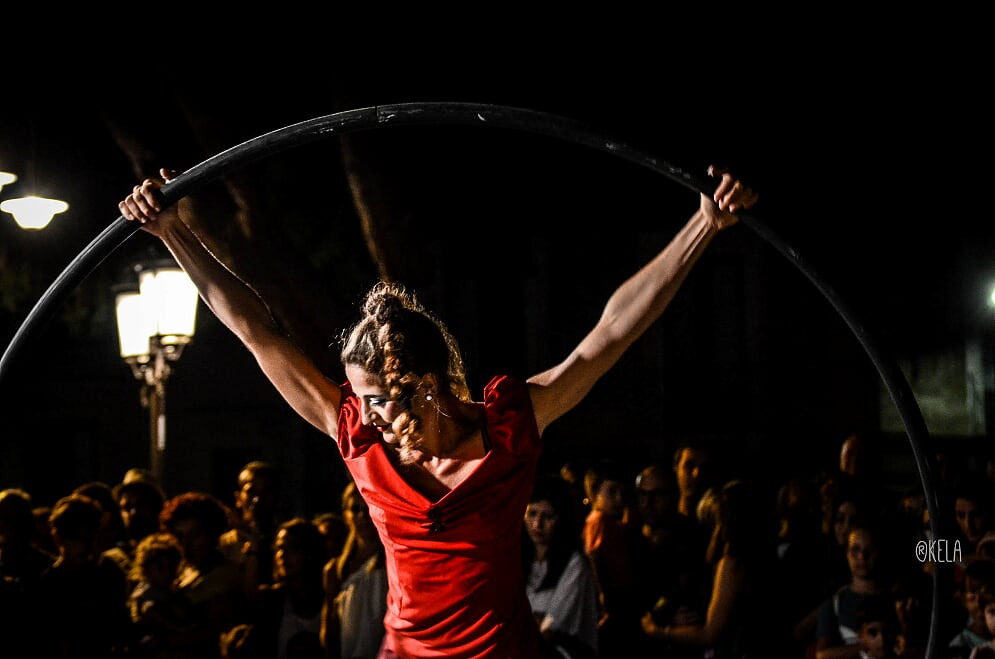 "Cyr wheel act durin the show ""Cometa"" at ""Ursino buskers""."