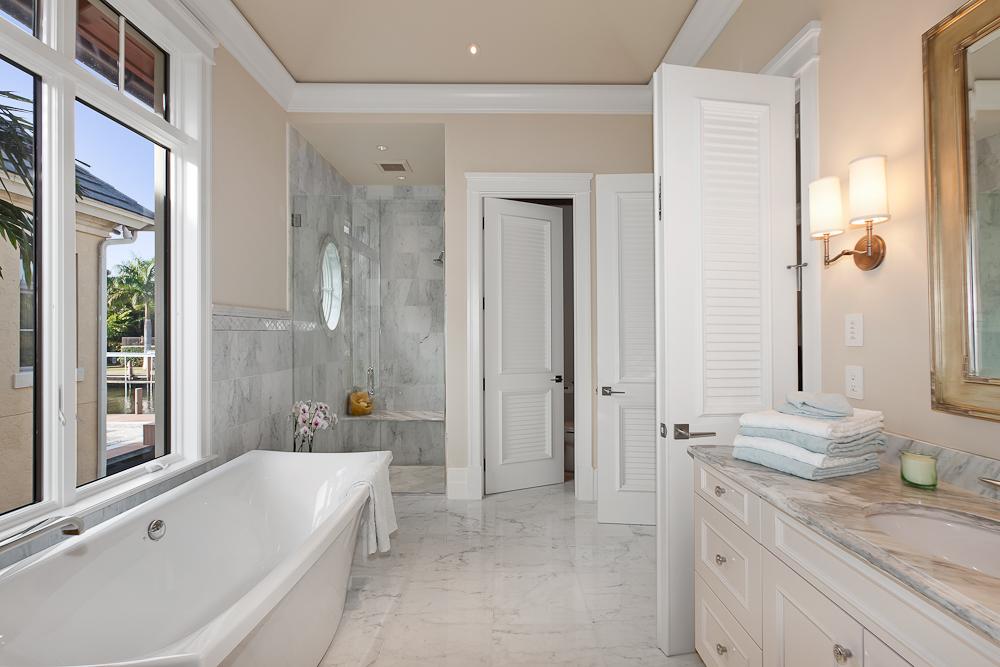 8 - Naples Boater's Dream - Her Master Bathroom.jpg