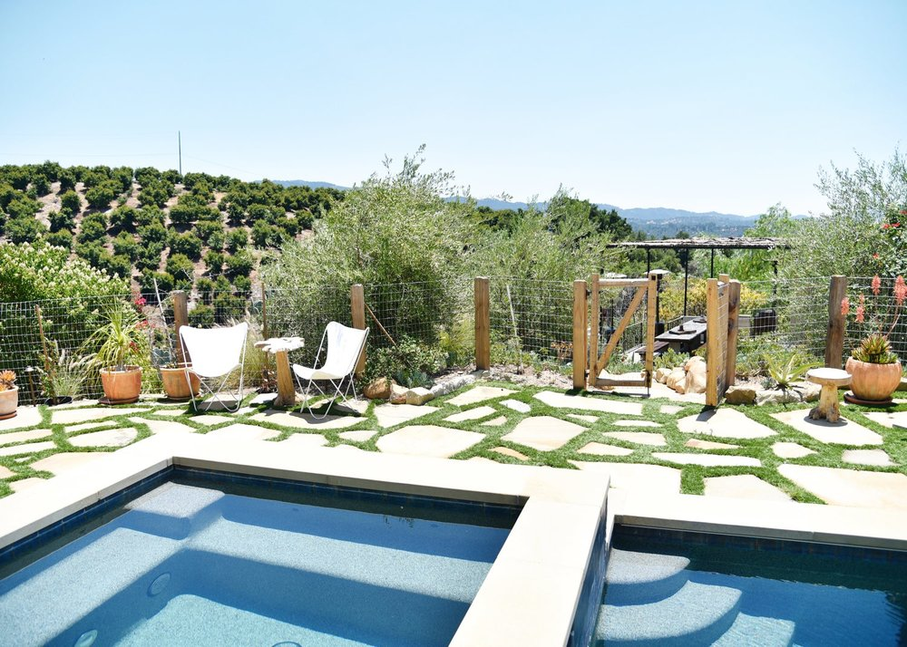 The Casa's pool and spa, with a view of the orchards.