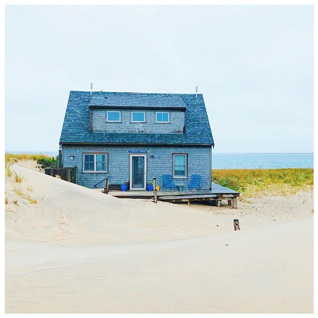"""One of the reasons Nantucket is so picturesque: all the homes have the same quintessential New England look! - The shingle homes all have a beautiful grey faded look to them from the sea breeze. The whole island has a calm and """"softly faded feel,"""" with the beige sand and blues ocean too. When we visited, it was really foggy one day, which exaggerated this feeling! - And when spring and summer come around, you have the sun and flowers adding some bright color to the landscape. But it's so cool to visit a city that almost entirely matches from the same style. We've only ever seen this in Santa Fe, Carmel and Boston's Back Bay before we traveled to Nantucket! - We recommend taking time to drive, bike or walk around the island to admire the architecture and homes. And make sure to Google whether a home tour is going on while you're there! You might just get lucky enough to step inside the houses too to see the white couches, driftwood decor and beach vibes!"""