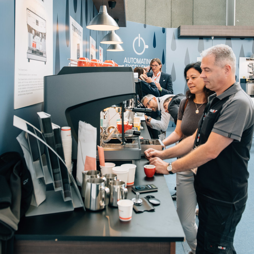 automating excellence - SCA has partnered with Cup of Excellence to launch Automating Excellence, a new initiative bringing together major super-automatic machine manufacturers to create a space where attendees can taste the world's finest coffee brewed by a selection of the most innovative fully-automated machines.Apply to Participate