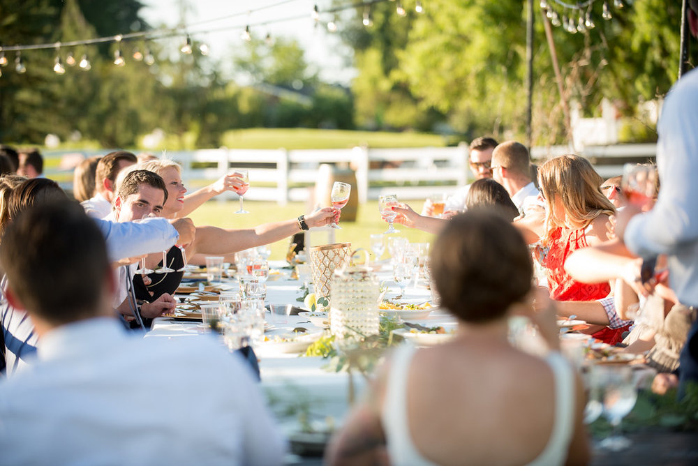 Wes Fisher Photography outdoor wedding reception in Eugene Oregon toasting bride and groom