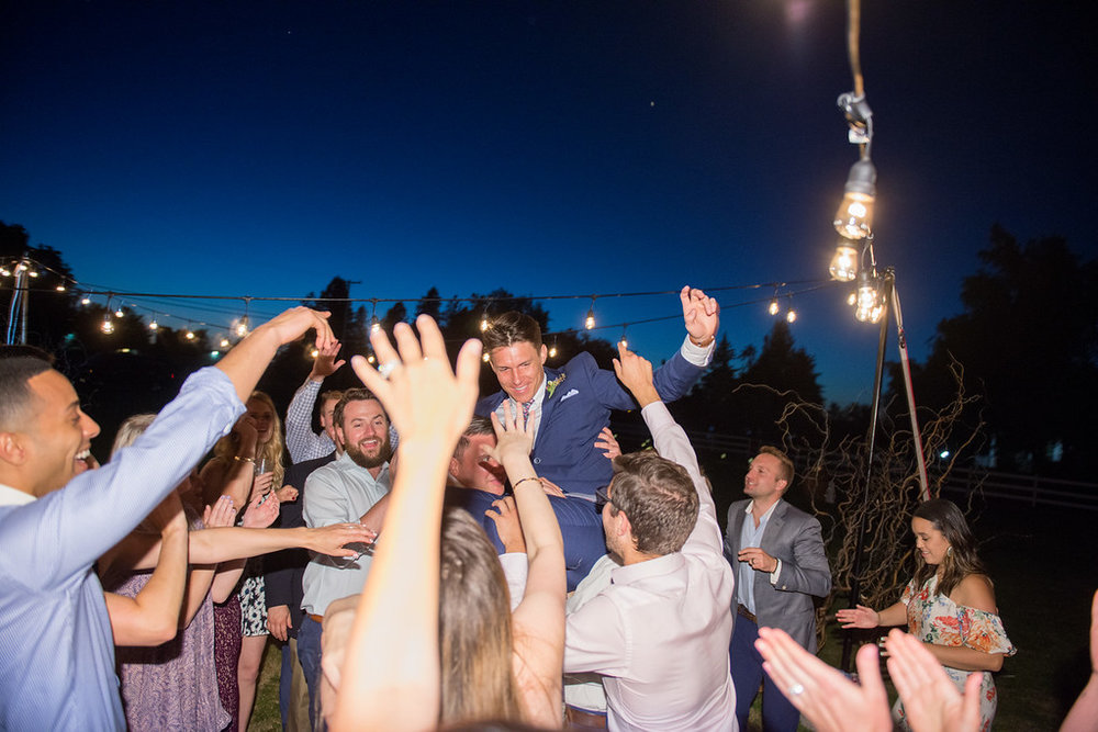 Eugene Oregon outdoor wedding reception with edison bulbs and dancing captured by Wes Fisher Photography
