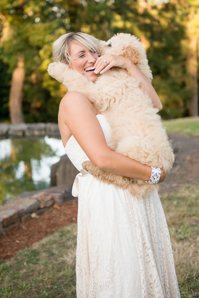 wes fisher photography - bride laughing with dog in arms.jpg