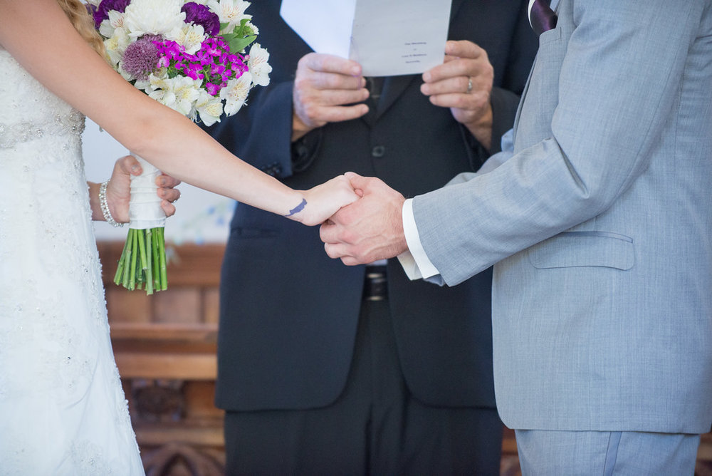 wes fisher photography - during the ceremony clasped hands.jpg