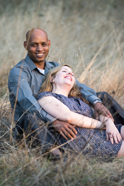 Wes Fisher Photography - Engagement - interracial couple in field.jpg