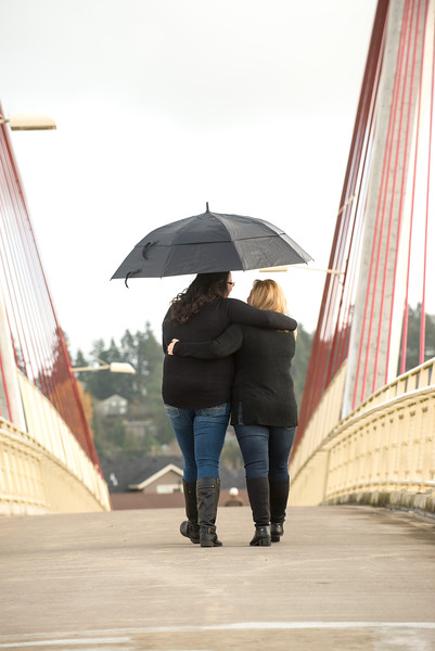 Wes Fisher Photography - Engagement - lesbian couple on bridge in the rain.jpg