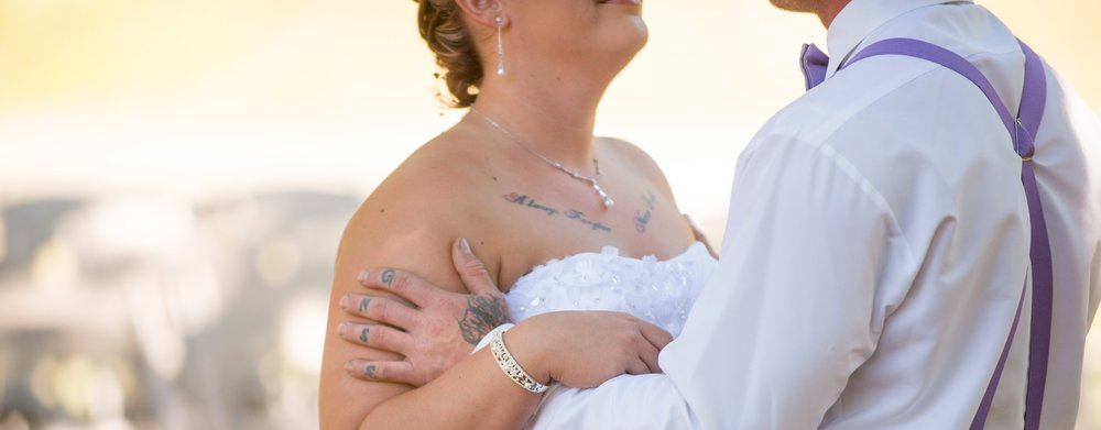 wes fisher photography - bride and groom with tattoos.jpg