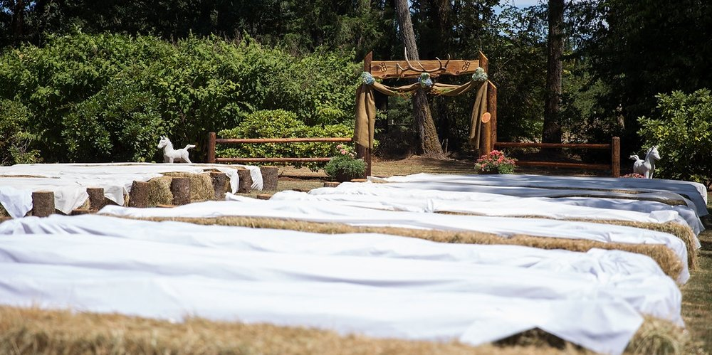 A backyard wedding using hay bales as seating