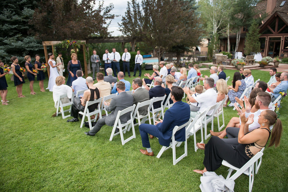 wedding guests at outdoor ceremony in oregon