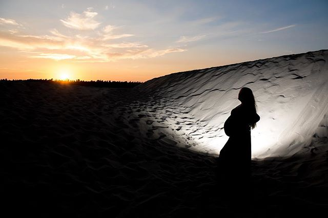 Lots going on here. This is out at the dunes in Florence. I put a flash on the ground behind my beautiful wife facing the dune. I exposed for the sunset and this is the result. Pretty cool shot of this amazingly strong and beautiful woman.